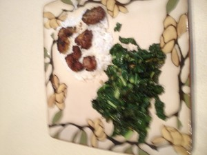 The finished dinner. Kidney slices on rice with sauteed kale